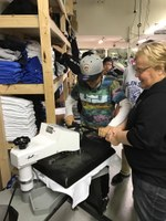Sue Isbell (right), the NDSU Extension Service's 4-H youth development agent in Sioux County, works with a youth at Sioux Image. It's an embroidery, printing and silkscreening business Isbell partnered with Solen High School to develop to give youth in grades seven to 12 hands-on experience in operating a business. (NDSU photo)