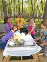Youth receive a lesson in outdoor cooking at the North Dakota 4-H Camp near Washburn. (NDSU photo)