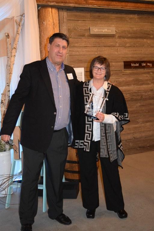 Kathleen Tweeten receives the Rural Leadership North Dakota Leader Award from Mike O'Keeffe, RLND Council chairman, during the RLND Class VII graduation gala. (NDSU photo)