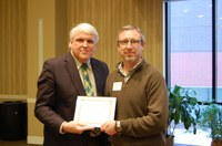 Marc Bauer, right, receives the William J. and Angelyn A. Austin Excellence in Advising Award from David Buchanan, associate dean for academic programs. (NDSU photo)