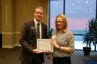 Miranda Meehan receives the Myron and Muriel Johnsrud Excellence in Extension/Outreach Award from NDSU Extension Director Chris Boerboom. (NDSU photo)