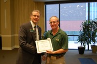 Rick Schmidt. right, receives the AGSCO Excellence in Extension Award from NDSU Extension Director Chris Boerboom. (NDSU photo)