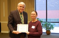 Shelley Horne receives the Charles and Linda Moses Staff Award from David Buchanan, associate dean for academic programs, (NDSU photo)
