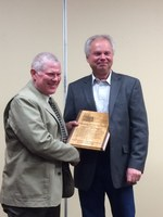 Myron Blumhagen (left), a producer from Drake, receives the Distinguished Service Award from Del Gates, president of the North Dakota Crop Improvement and Seed Association. (NDSU photo)