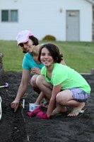 A North Dakota family plants seeds in their home garden to help test new varieties. (NDSU Photo)