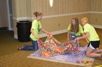 Youth make blankets as a community service project during the Extension Youth Conference in Fargo. (NDSU photo)