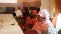 Ransom exchanges information with women's groups while volunteering in Senegal. (NDSU Photo)