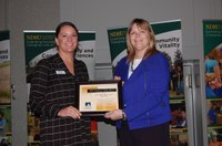 Mary Mertens, North Dakota Farmers Union member relations specialist (left), receives the 2017 Friend of the North Dakota Extension Association of Family and Consumer Sciences from Julie Garden-Robinson, NDSU Extension food and nutrition specialist and president of the association. (NDSU photo)