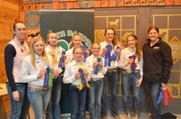 A Ward County team took first place in junior division horse judging and intermediate division hippology. Pictured are, from left (front row): coach Emily Goff and team members Mackenzie Wipf, Haley Buck and Sadie Lemer; (back row); team members Macey Moore, Hailey Schauer, Anne Schauer and Emily Fannik, and coach Paige Brummund. (NDSU photo)