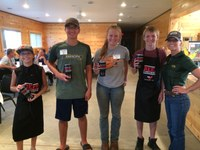The Richland County team of (from left) Greyson Matejcek, Gunnar Miller, Sherilyn Gutzmer and Mason Miller took first place in the senior division of 4-H Grill-off. Leigh Ann Skurupey, NDSU Extension 4-H youth development specialist for animal sciences, is on the right. (NDSU photo)