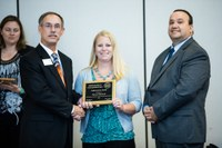 Alicia Harstad, NDSU Extension agriculture and natural resources agent in Stutsman County, receives the Achievement Award from Alan Galloway, president of the National Association of County Agricultural Agents (left) and Bill Viar from the American Income Life Insurance Co., which sponsored the award. (Photo courtesy of NACAA)