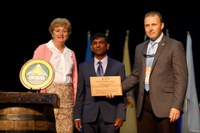 Mohamed Khan, NDSU Extension sugar beet specialist (center) receives the National Creative Excellence Award from Elizabeth Claypoole, president of Epsilon Sigma Phi, and James Henderson, president of the Association of Natural Resource Extension Professionals. (Photo courtesy of NACAA)