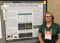Penny Nester, NDSU Extension agriculture and natural resources agent in Kidder County, is recognized at the National Association of County Agricultural Agents' conference for a poster on the impacts of bale grazing on soil health and herbage production in south-central North Dakota. (NDSU photo)