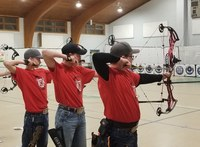 The Ward County archery team of (from left) Kaden Korgel, Tate Novodvorsky and Ethan Myers competes at the Minot Northwest District match. (NDSU photo)
