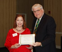 Aimee Thapa, left, receives the Donald and Jo Anderson Staff Award from David Buchanan, associate dean for academic programs. (NDSU photo)