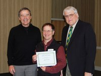 Joel Caton, center, receives the Eugene R. Dahl Excellence in Research Award from Howard Dahl, left, and David Buchanan, associate dean for academic programs. (NDSU photo)