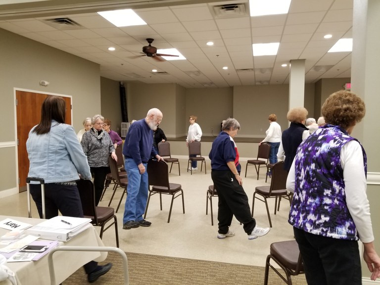 Seniors practice exercises that will help them improve their balance and muscle strength and reduce their risk of falling. (NDSU photo)