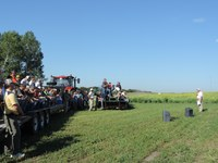 Visitors learn about crop research during a field tour at the North Central Research Extension Center. (NDSU photo)