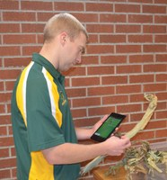 Andrew Friskop, NDSU Extension plant pathologist, demonstrates how to use the NDSU Pest Management app. (NDSU photo)