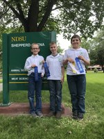 The Stark-Billings County team takes first place in the junior division of the State 4-H Meat Judging Contest. Team members are (from left): Mark Schmidt, Joel Schulz and Ryan Schumacher. (NDSU photo)