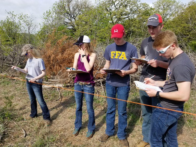 Foster County's 4-H range management team evaluates a range site. Pictured are (from left): Beth Lee, Chayla Kuss, Tyler Lee, Mathias Kubal and Adam Gorseth. (NDSU photo)