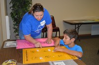 A 4-H volunteer helps a 4-H'er with a bird identification project. (NDSU photo)