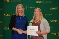 Alicia Harstad, right, receives an Extension Program Excellence Award. (NDSU photo)