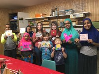 """Members of the Uniters 4-H Club in Cass County display the """"get well"""" cards they made for children in a local hospital. (NDSU photo)"""