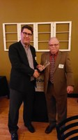 Michael O'Keeffe, left, accepts Rural Leadership North Dakota's Leader Award from Barry Medd, RLND Council chair. (NDSU photo)