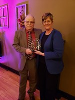 Pam Musland, communications director for the North Dakota Farmers Union, accepts Rural Leadership North Dakota's Champion Award from Barry Medd, RLND Council chair. (NDSU photo)