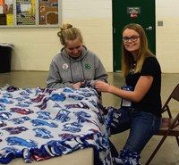 4-H youth make a blanket for the LEO's Blanket Project during the recent Leadership Awareness Weekend, a 4-H civic engagement event. (NDSU photo)