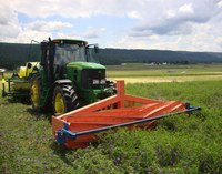 A roller-crimper rolls down a hairy vetch-triticale cover crop. (NDSU photo)