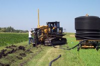 A crew installs a tile drainage system. (NDSU photo)