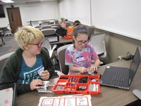 Youth build and program robots during a pilot after-school 4-H robotics program in McKenzie County. (NDSU photo)