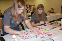 Former 4-H youth from Mercer County create a poster for a food drive for the local food pantry. (NDSU photo)