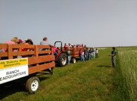Participants at a past DREC field day tour learn about research being conducted at the center. (NDSU Photo)