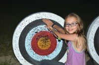 A youth pulls an arrow from a target during an archery camp at the North Dakota 4-H Camp near Washburn. (NDSU photo)