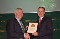 Brad Cogdill, Center for 4-H Youth Development chair, is honored for his 40 years of service to NDSU Extension.