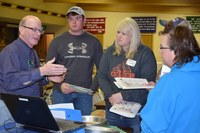 Dean Aakre, NDSU Extension 4-H youth development specialist (left) talks to volunteers during a project training session. (NDSU photo)