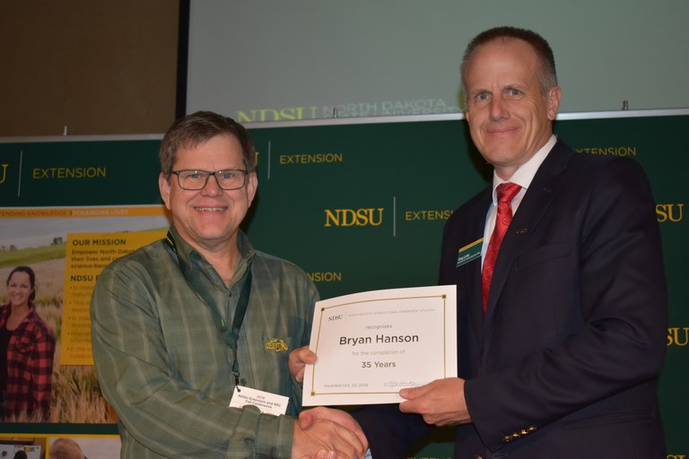 Bryan Hanson, research agronomist, is honored for his 35 years of service to the Langdon Research Extension Center.