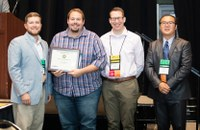 Chris Augustin, second from left, received second place nationally in the poster category, applied research division, during the National Association of County Agricultural Agents conference. (NDSU photo)