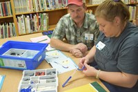 4-H volunteers Edwin and Susanna Hein of Rolette County attend a 4-H volunteer project training in Cando, N.D. (NDSU photo)