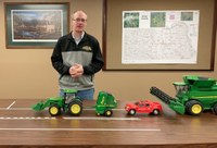 NDSU Extension agent Rick Schmidt uses models to demonstrate road safety involving farm equipment. (NDSU photo)