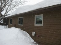 Most roofs are designed to handle the snow load of a typical winter. (NDSU photo)