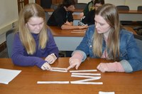 Youth learn about the judicial system by deciphering puzzles to get codes that opened locks on a box during the Leadership Awareness Weekend that NDSU Extension's Center for 4-H Youth Development hosted. (NDSU photo)