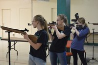 North Dakota 4-H'ers take aim in air rifle competition. (NDSU photo)