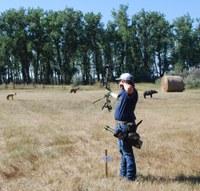 A 4-H'er takes aim at the North Dakota State 4-H Archery Championships held at the North Dakota 4-H Camp near Washburn. (NDSU photo)