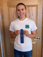 Faith Norby shows off her award from the 2020 North Dakota 4-H consumer decision making contest. She is a member of the Stark-Billings County team who took first place in the senior division. (NDSU photo)