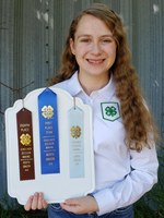Michaela Mitchell displays the awards she received as part of the Stark-Billings County team who took first place in the 2020 North Dakota 4-H consumer decision making contest. (NDSU photo)