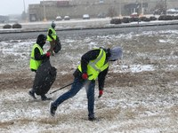 North Dakota 4-H Ambassadors clean trash from ditches in Bismarck as a community service project. (NDSU photo)